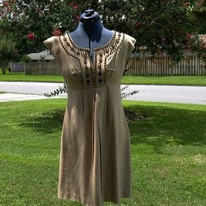 Gorgeous tan dress with wood bead detailing.
